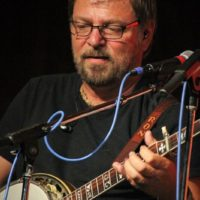 Ron Stewart with Seldom Scene at the August 2018 Gettysburg Bluegrass Festival - photo by Frank Baker