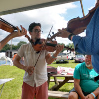 Thursday morning fiddle jam at the 2018 Podunk Bluegrass Festival - photo by Dale Cahill