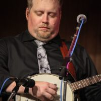 Keith McKinnon with IIIrd Tyme Out at the August 2018 Gettysburg Bluegrass Festival - photo by Frank Baker