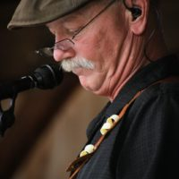 Fred Travers with Seldom Scene at the August 2018 Gettysburg Bluegrass Festival - photo by Frank Baker