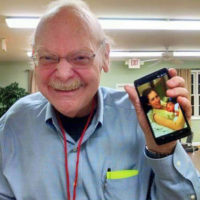 Proud grandpa George McCeney shares a photo on his phone