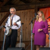 Terry and Cindy Baucom with The Dukes of Drive at the August 2018 Gettysburg Bluegrass Festival - photo by Frank Baker