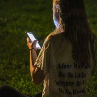 Staying connected at the August 2018 Gettysburg Bluegrass Festival - photo by Frank Baker
