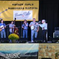 Little Roy Lewis takes over as MC at the Nothin' Fancy Bluegrass Festival - photo © Bill Warren