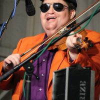 Michael Cleveland having a blast as Elmo Otto with Red Knuckles & The Trailblazers at the 2018 Delaware Valley Bluegrass Festival - photo by Frank Baker