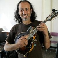 Diptanshu Roy with David Grisman's mandolin