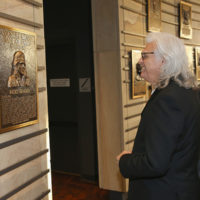 Ricky Skaggs examines his plaque after he is inducted into the Country Music Hall of Fame (10/21/18) - photo byTerry Wyatt/Getty Images