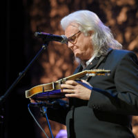 Ricky Skaggs examines Bill Monroe's mandolin after he is inducted into the Country Music Hall of Fame (10/21/18) - photo byJason Kempin/Getty Images