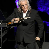 Ricky Skaggs marvels at Bill Monroe's mandolin at his induction into the Country Music Hall of Fame (10/21/18) - photo byTerry Wyatt/Getty Images