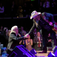 Ricky Skaggs thanking Chris Stapleton at the Country Music Hall of Fame (10/21/18) - photo byJason Kempin/Getty Images