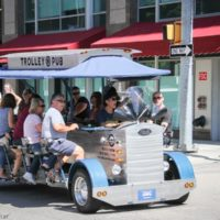 Pedal along on the Trolley Pub during StreetFest at Wide Open Bluegrass 2018 - photo © Frank Baker