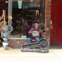 Busking in the shade at the 2018 Bristol Rhythm & Roots Reunion - photo by Teresa Gereaux