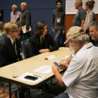 Cane Mill Road talks to promoters at the 2018 World of Bluegrass - photo © Frank Baker