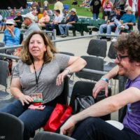 Rare photo of IBMA publicist Judy McDonough sitting down at Wide Open Bluegrass 2018 - photo © Frank Baker