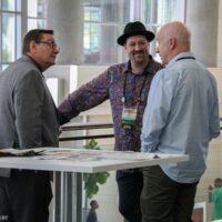 Corridor discussion with Joe Mullins, Stephen Mougin, and Ben Surratt at World of Bluegrass 2018 - photo © Frank Baker