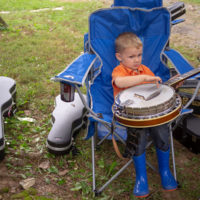 Ryan McKenzie, son of Karne McKenzie, trys his hand at a clean banjo roll.  Tom Mindte, Rodger Nelson & Steve Benedik's Fall Pickin' Party, held this year in Woodbine, MD. 6 - 7 October, 2018. Photo by Jeromie Stephens