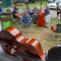 Front porch view of the parking lot jam. Tom Mindte, Rodger Nelson & Steve Benedik's Fall Pickin' Party, held this year in Woodbine, MD. 6 - 7 October, 2018. Photo by Jeromie Stephens
