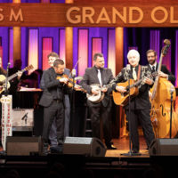 Del McCoury Band on the Grand Ole Opry presents Del McCoury with a 15th Anniversary print (11/3/18) - photo by Chris Hollo