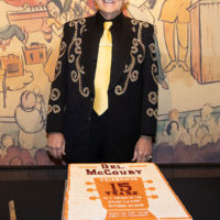Del McCoury with his 15th Anniversary cake at the Grand Ole Opry presents Del McCoury with a 15th Anniversary print (11/3/18) - photo by Chris Hollo