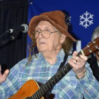 Hobo Joe, aka Danny Stanley, joins the Garrett Newton Band at 2018 Bluegrass Christmas in the Smokies - photo © Bill Warren