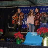 Alyssa and Wayne Brewer sing with Gary Brewer & The Kentucky Ramblers at the 2018 Bluegrass Christmas in the Smokies - photo © Bill Warren