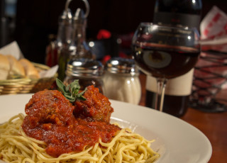 Scratch made meatballs with tomato sauce and fresh pasta 320x230