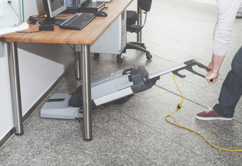 Cleaning under tables with the Advance SC100 Upright Floor Scrubber