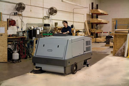 Advance 7765 industrial sweeper scrubber sweeping in a warehouse
