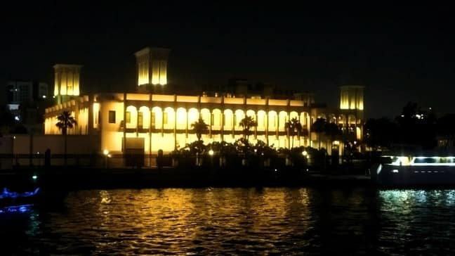 dhow cruise view of lit building