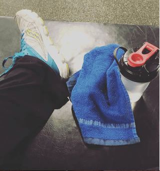 exercise mat with bottle and towel