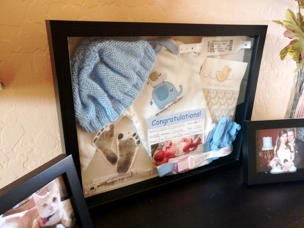 baby, shadow, box, craft, diy, do it yourself, outfit, card, footprint, pregnancy test, hospital, bracelet, newborn, details, hat, onesie, mittens, display, memories, parenthood, motherhood, babyhood, infant, fatherhood, blue, awesome, lifestyle, home, momblogger