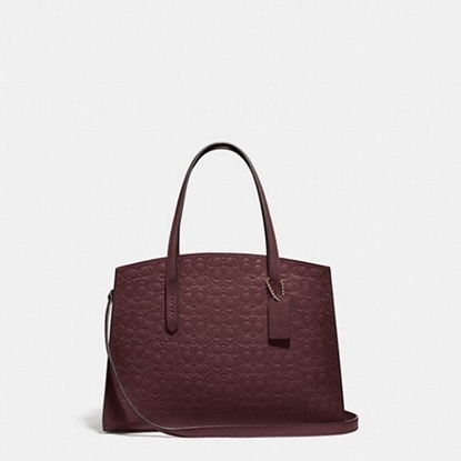 Picture of Coach Signature Charlie Carryall - Oxblood/Gold