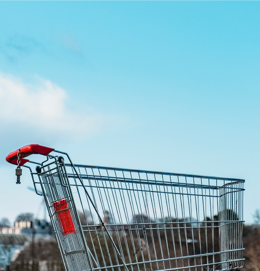 Blog header image with shopping cart outside with blue sky behind it