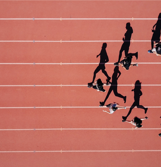 Blog feature image, line of people running on track in v formation