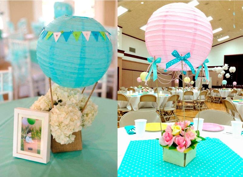 centros de mesa de niño y niña con globos para recuerdo de bautizo