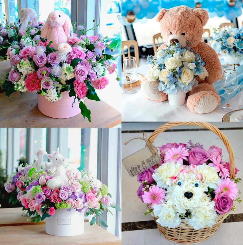 centros florales para bautizo de niño y niña con peluche de oso, conejo, unicornio y perro