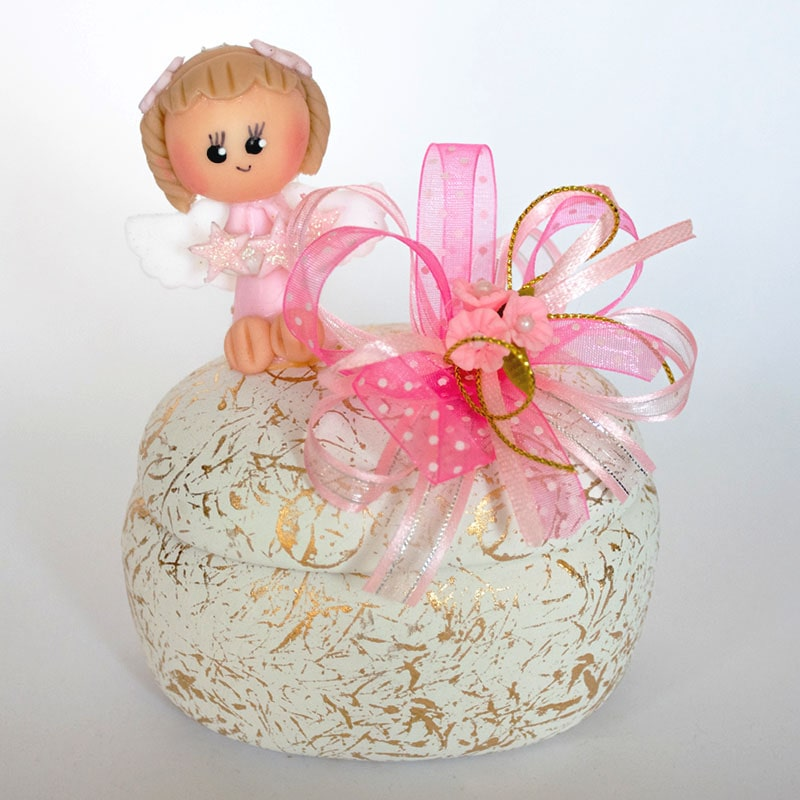 alhajero ovalo de yeso con muñequita hecha de pasta francesa para recuerdo de bautizo de niña