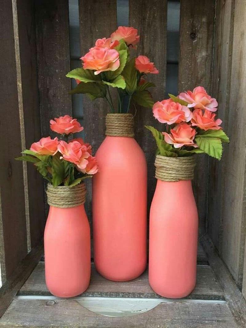 Florero rosa con botella de vidrio para recuerdo de bautizo de niña