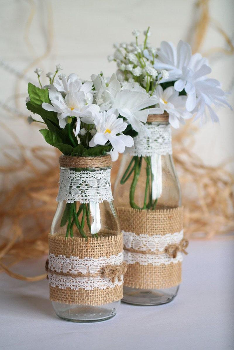 florero con botella de cristal reciclada para recuerdo de bautizo de niño y niña