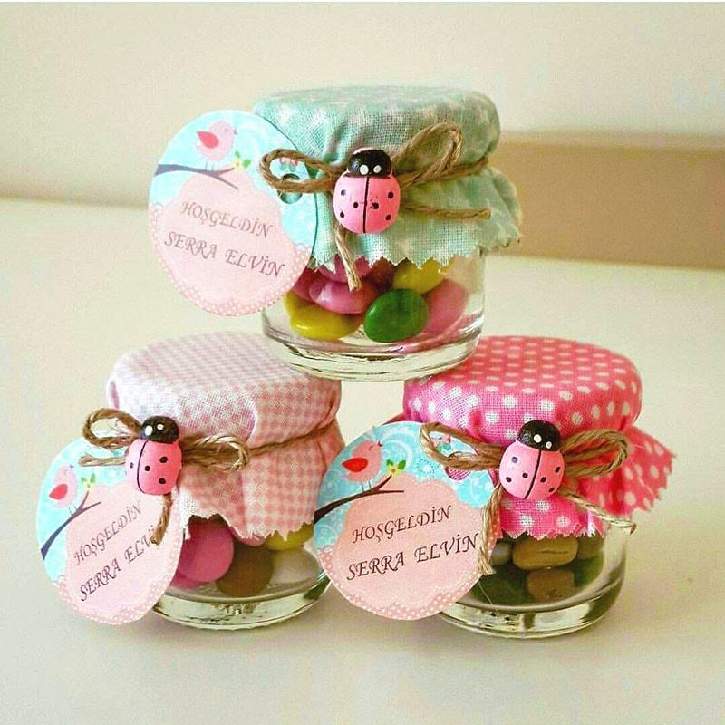 frascos de gerber rellenos de dulces para recuerdo de bautizo de niño y niña