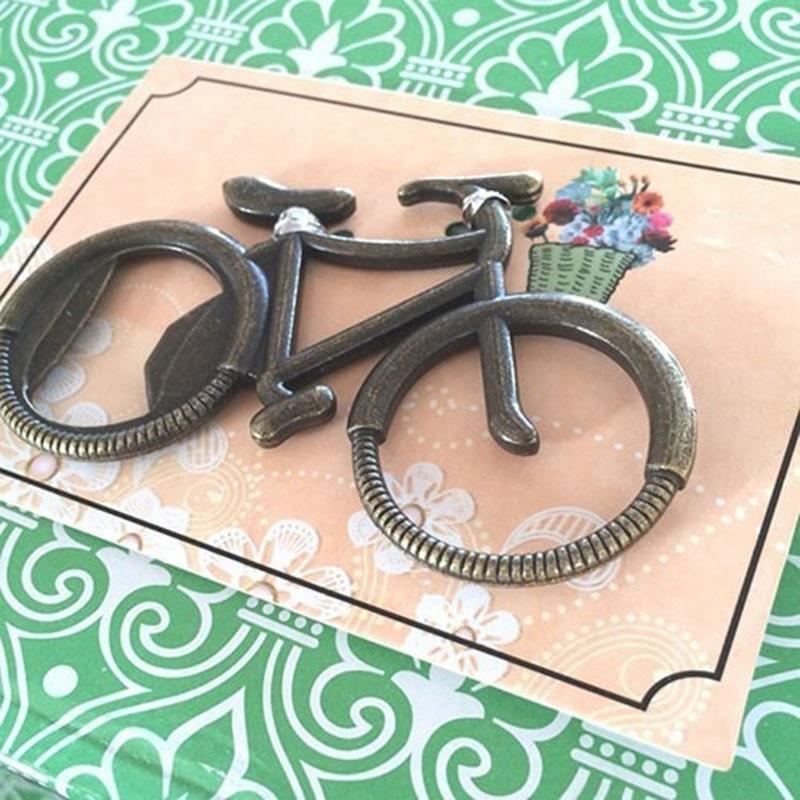 destapador en forma de bicicleta para bautizo de niña y niño