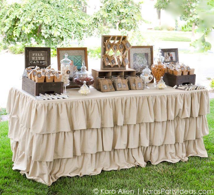 mesa_de_dulces_para_bautizo_niño_estilo_vintage_jardín_aire_libre_elegante_