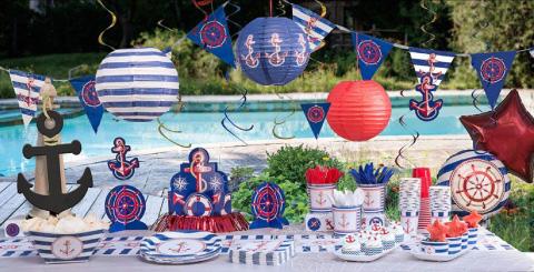 mesa de dulces con tematica de marinerito para bautizo o baby shower