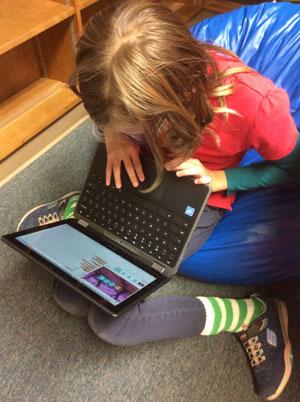 Student coding in Media Center