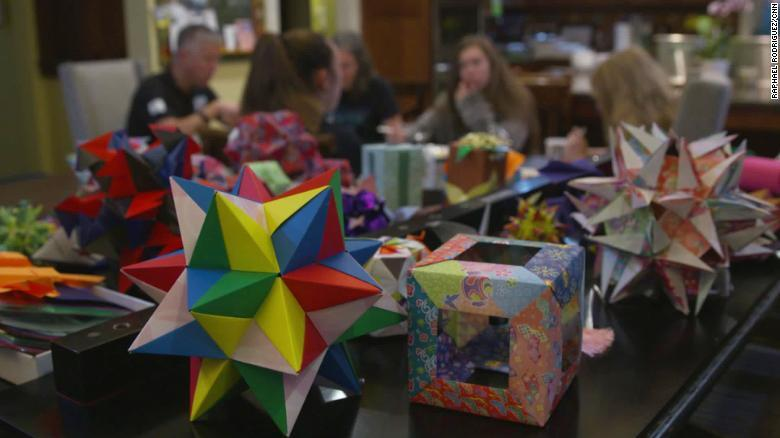 Origami is displayed throughout the Adams family home.