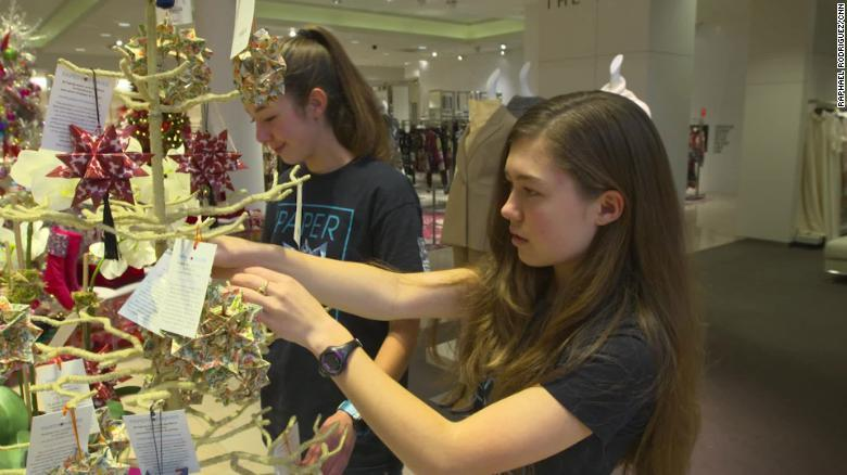 Isabelle and Katherine Adams check out the display of their ornaments at a Neiman Marcus store near their Dallas home.