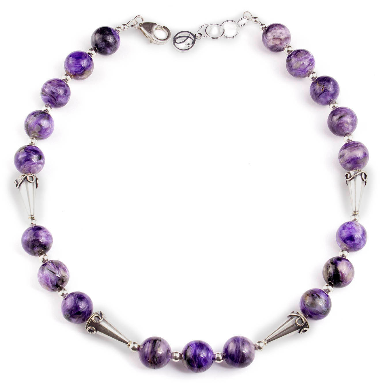 Handcrafted bead jewelry made with purple charoite and Bali silver