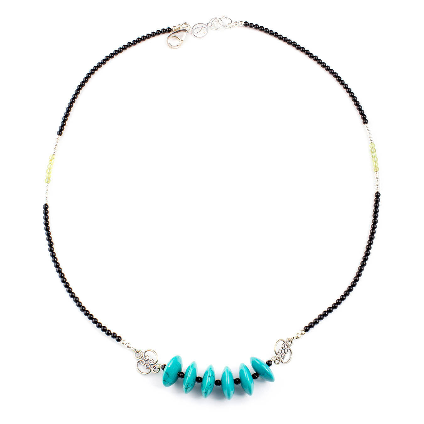 Handcrafted necklace made with turquoise, peridot, and bali silver