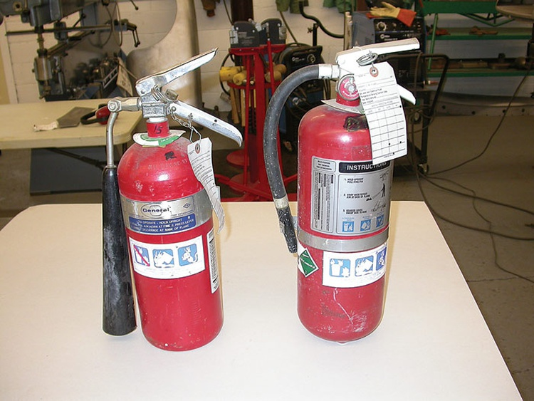 Keep several quality fire extinguishers in your shop. The one on the left is a carbon dioxide unit and won't make a mess when it puts out the fire.