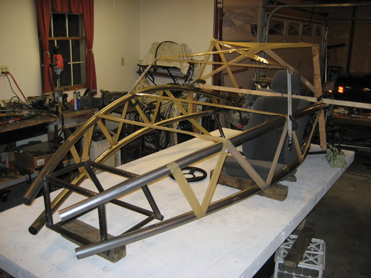 The Honda's drivetrain and subframe are situated behind the driver.